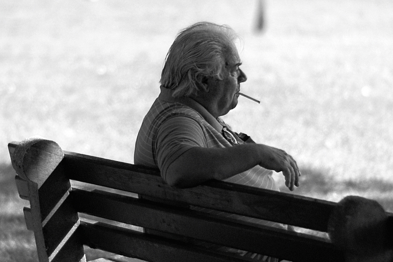 Man on bench (100% crop).
