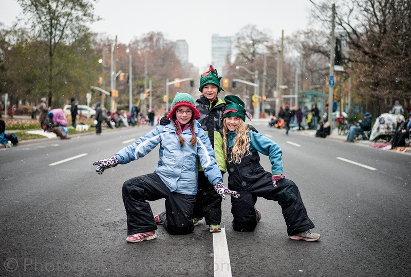 At the Santa Claus Parade (the kids strike a pose)